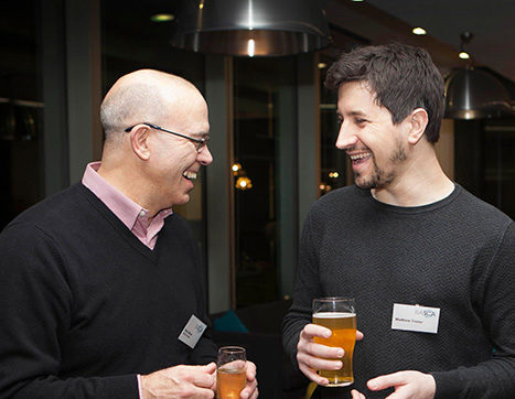 Two Academy members networking at an event