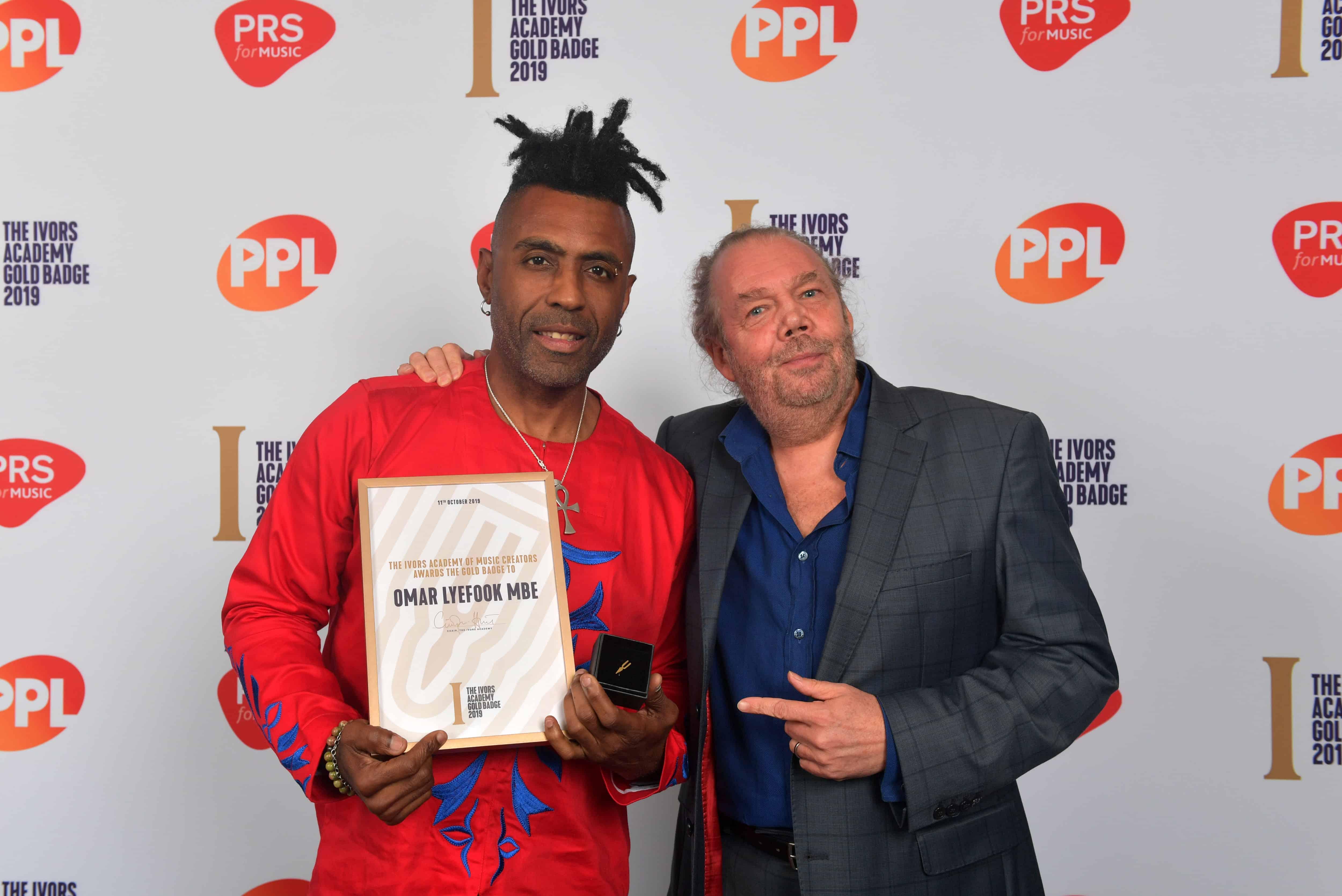 Gold Badge recipient Omar Lyefook MBE with presenter Gordon Mac